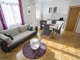obývací pokoj 12 m2, počet lůžek 1 (pohovka)